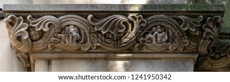 Elements of architectural decorations of buildings on the streets in Catalonia, public places. #1241950342