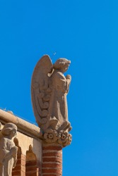 Elements of architectural decorations of buildings, sculptures and statues, gypsum stucco and plaster ornaments. On the streets in Catalonia, public places.