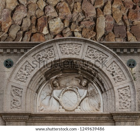 elements of architectural decorations of buildings, windows and arches on the streets in Catalonia, public places. #1249639486