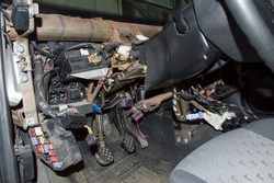 Elements of the car's electrical wiring under the removed dashboard