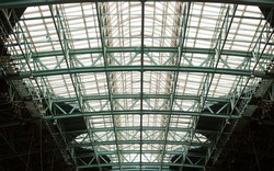 Elements of the metal structure of the roof of the exhibition complex, background