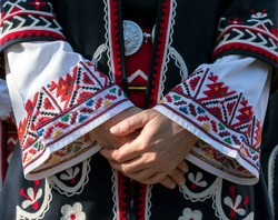 Elements of traditional Bulgarian folk costume with embroidery. A Female singer from Trakia folk ensemble and details of old, traditional dress. Photographed in Plovdiv, Bulgaria