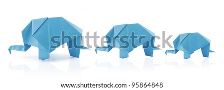 elephant family in origami tehnique on the white background