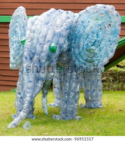Elephant made from plastic bottles. Concept of how to make useful and beautiful things from garbage #96951557