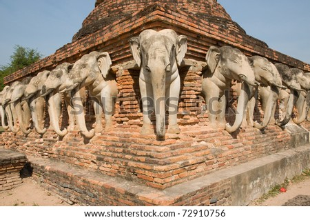 "elephant statue around pagoda at ancient temple "" Wat Chang Lom"" at Sukhothai historical park Sukhothai province Thailand"