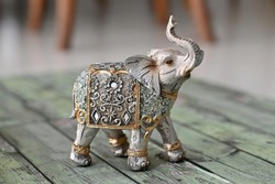Elephant statue craft with vintage elegant gold and silver traditional ornaments.