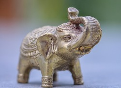 Elephant Statue Micro Zoom Defocused Close Up. Bronze carving detail. Environment relaxation zen energy. Eastern Culture Product Picture