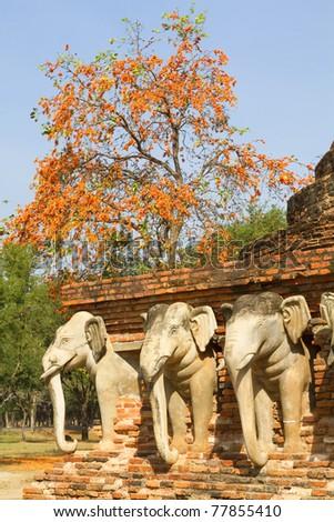 Elephant statues around the stupa at Sukhothai, Thailand