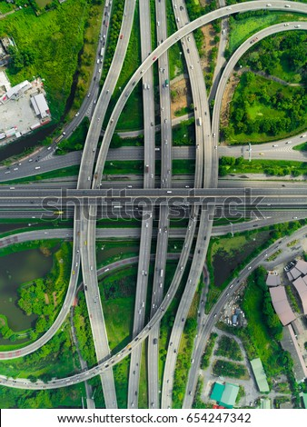 Elevated expressway. The curve of suspension bridge, Thailand. Aerial view. Top view. Background scenic road. #654247342
