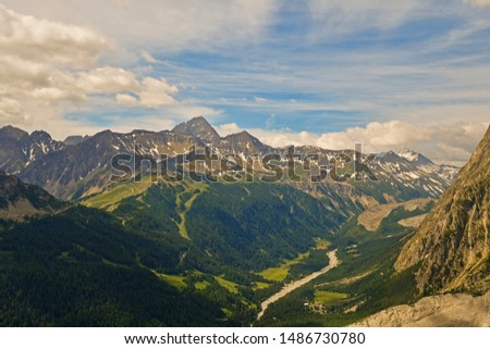 Elevated mountain view from the massif of Mont Blanc in the Italian Graian Alps with the Val Veny valley in summer, Courmayeur, Aosta Valley, Italy #1486730780