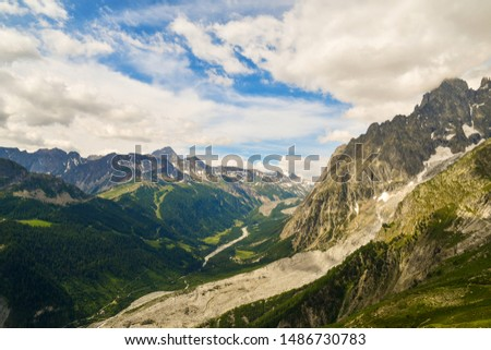 Elevated mountain view from the massif of Mont Blanc in the Italian Graian Alps with the Val Veny valley in summer, Courmayeur, Aosta Valley, Italy #1486730783