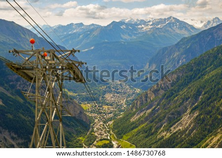 Elevated, panoramic view of the valley of Courmayeur, a famous tourist destination,  from the Pavillon / The Mountain cable car station in the Italian Alps in summer, Aosta Valley, Italy #1486730768