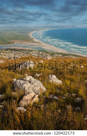 elevated scenic view from a mountain top over the coastline and sea