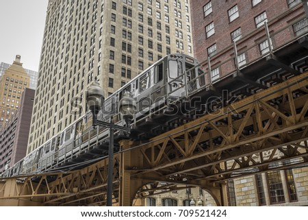 elevated train moving in front...