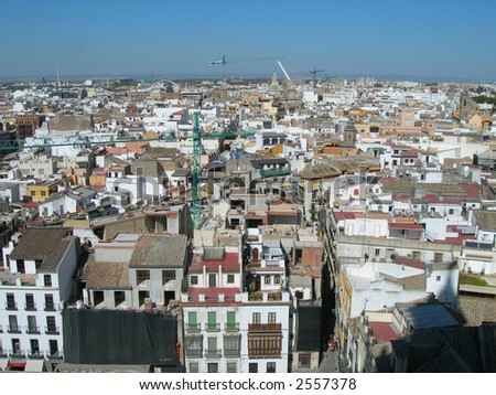 Elevated view and old City maze perspective with roofs and skyline in Spain