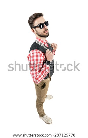 Elevated view of bearded young hipster holding suspenders. Full body length portrait isolated over white studio background.  #287125778