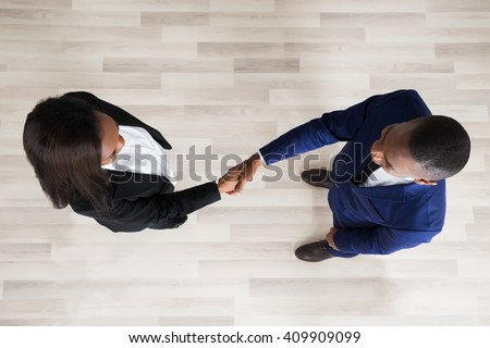 Elevated View Of Business Man And Woman Handshaking