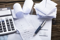 Elevated View Of Calculator And Pen On Receipt In Office
