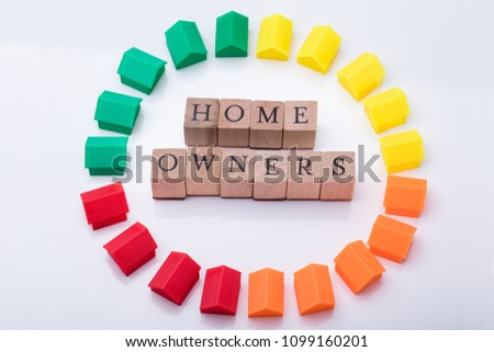 Elevated View Of Homeowner Association Wooden Blocks Surrounded With Multicolored House Models #1099160201