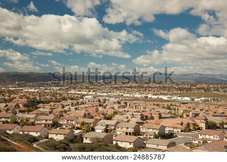 Elevated View of New Contemporary Suburban Neighborhood and Majestic Clouds.