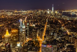 Elevated view of New York City at night.