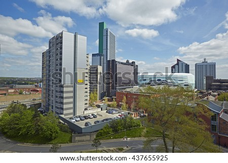 Elevated view of skyscrapers, hotels and arena in the North of Leeds under blue skies #437655925