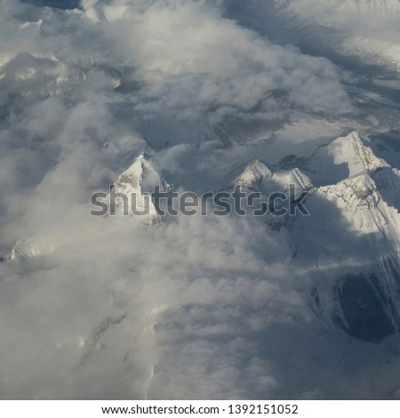 Elevated view of snow covered mountain peaks, Sun Peaks, British Columbia, Canada