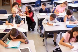 Elevated view of teacher and kids in elementary school class