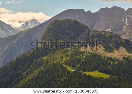 Elevated view of the Italian Alps from the Mont Blanc massif with the Chetif mountain (2343 m) covered with conifer forests in summer, Courmayeur, Aosta Valley, Italy #1500343895