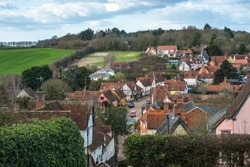 Elevated views across Kersey village and the countryside from the hill at St Mary's Church. Suffolk, East Anglia, England, UK.