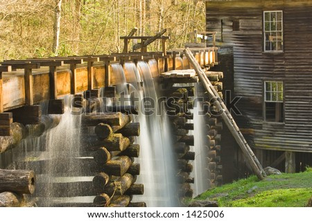 elevated wooden sluice carries water to old grist mill in smoky mountains national park
