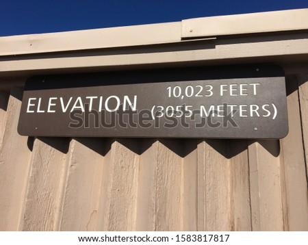 Elevation 10,023 feet 3055 meters sign symbol mountain peak top height Haleakala Hawaii #1583817817
