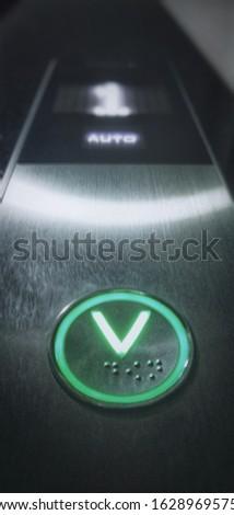Elevator button switch in focus.