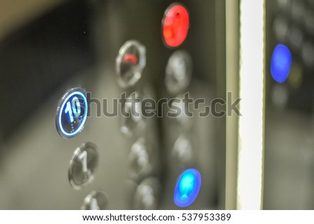 Elevator in a building pressing button #537953389