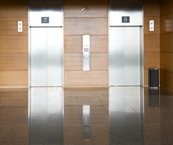 Elevator with two silver door