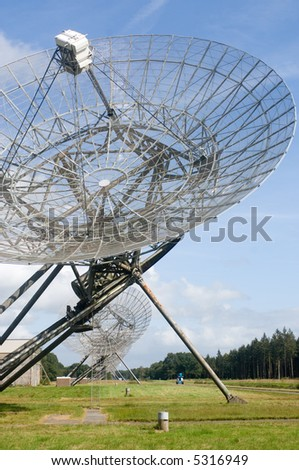 Eleven radio Telescopes facing upwards, receiving signals from outer space