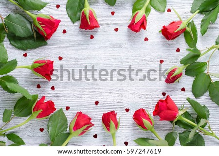 eleven red rose and hearts with copy space on the vintage wooden #597247619