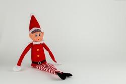Elf on a shelf on a white background.