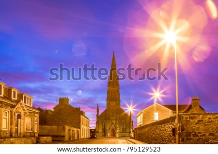 Elgin. Sunrise in Scottish city. Beautiful violet sky. Street style photos