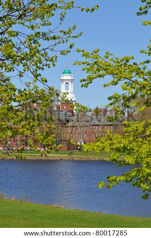 Eliot House, Harvard University, across Charles River. White tower and green dome framed by spring leaves.