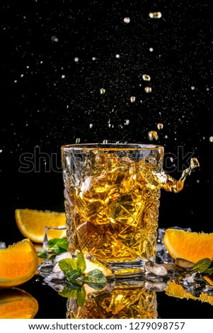 Elite alcoholic drink closeup. Two cognac portions in glass on black background, menu photo, copy space.