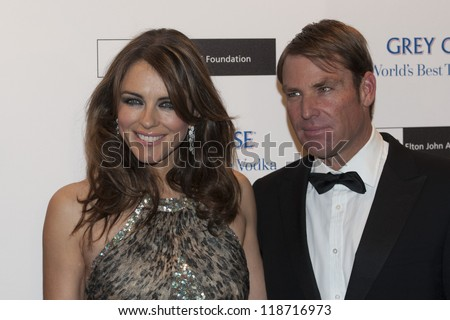 Elizabeth Hurley and Shane Warne arriving for the Grey Goose Ball 2012, Battersea Power Station, London. 10/11/2012 Picture by: Simon Burchell