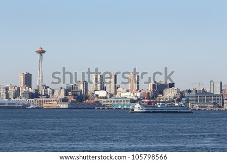 Elliott Bay, Washington State Ferry, Seattle. The view across Elliott Bay at downtown Seattle and the Space Needle. A Washington State Ferry moves across the bay. USA.