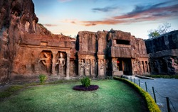 Ellora cave entrance in Kailas temple with ancient carved wall near Aurangabad, Maharashtra, India