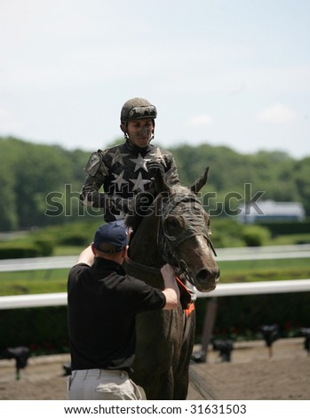 ELMONT - JUNE 6: Justin P with Jose L. Rivera, Jr. aboard covered with mud after the first race at Belmont Park on Belmont Stakes Day - June 6, 2009 in Elmont, NY.