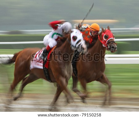 ELMONT, NY - JUN 11: Female jockey Maylan Studart (orange cap) competes in The True North Handicap at Belmont Park on June 11, 2011 in Elmont, NY.