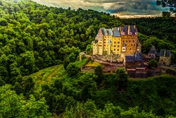 Eltz Castle in Rhineland-Palatinate, Germany. Beautiful landscape with medieval architecture.