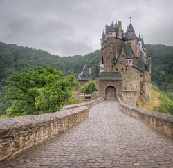 Eltz Castle is a medieval castle nestled in the hills above the Moselle River between Koblenz and Trier, Germany