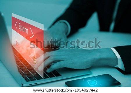 Email concept with laptop spam and virus computer monitor internet security concept, businessman reading electronic mail with a laptop. Spam, junk and e-marketing on screen, Spam Email Pop-up Warning. Сток-фото ©