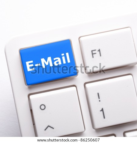 email e-mail or internet communication concept with key on keyboard